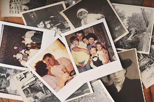 Pile of family photographs on a table