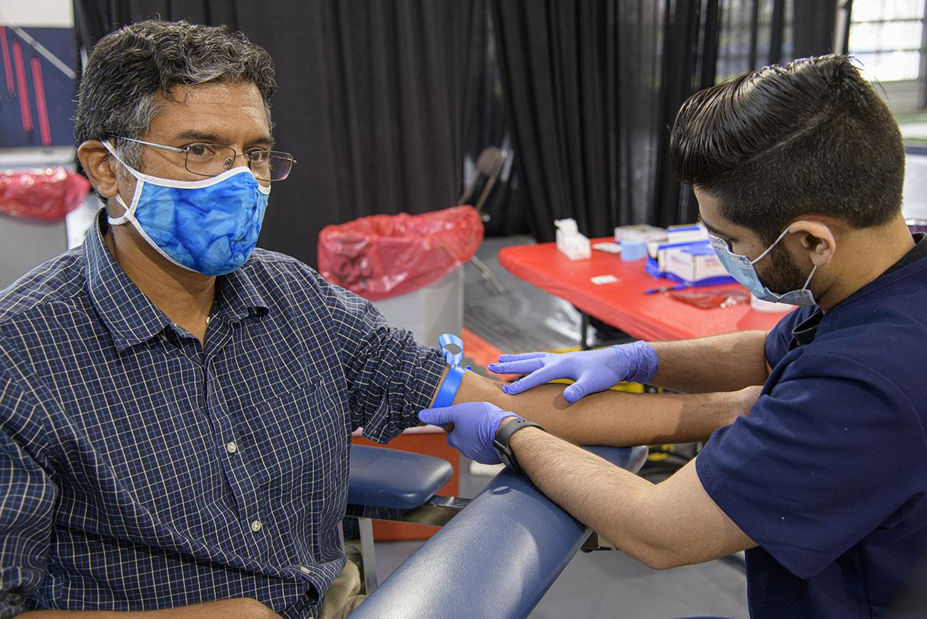 Deepta Bhattacharya, PhD, gets blood drawn for the antibody test he helped develop.